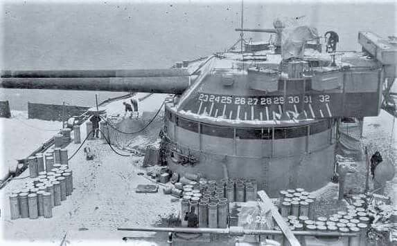A snowy battleship USS Texas (BB-35). The snowy scene of the No. 4 Turret shows the long base range finder mounted on the back of the turret and the 3AA battery on the wing platforms.