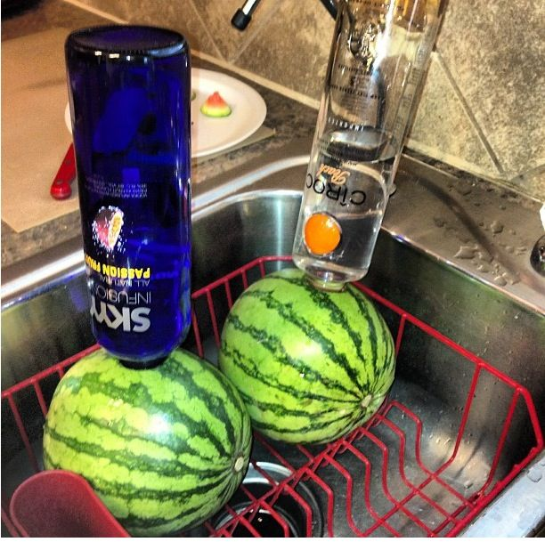 Drunken watermelon  (Put a hole in the watermelon deep enough for the bottle to stay up right) party's drinks fun & easy & cheap
