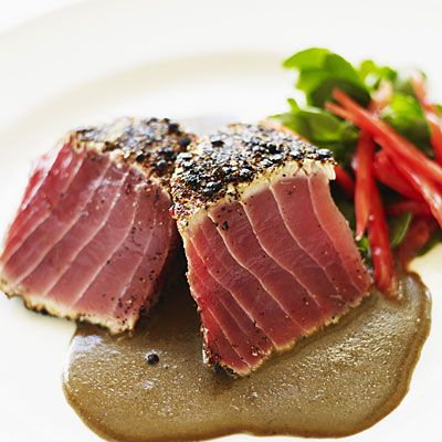 This Southwestern Tuna recipe, packed with healthy fats and metabolism-boosting spices, is a proven belly flattener! Brush a 4-oz yellowfin tuna fillet with 1 tsp olive oil; sprinkle with 1/4 tsp each chili powder, ground cumin, and black pepper. Grill to desired doneness; top with salsa. | health.com