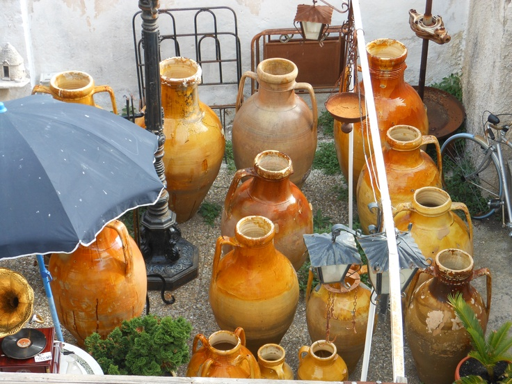 This is a photo of the handmade olive oil and wine ceramics made in the Puglia region of Italy.