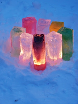 Lyhdyt Watercolor paint-laden water poured into milk cartons and allowed to freeze in snow; lit as lanterns.