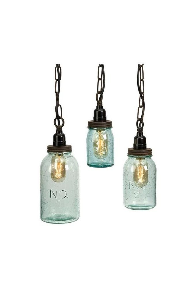 You'll love the rustic farmhouse look of these Mason Jar Pendant Lights. This set of three hanging lights is perfect for showing off a vintage-look light bulb through the seeded glass. The screw-top detail makes these unique light fixtures the perfect addition to the kitchen or breakfast nook.