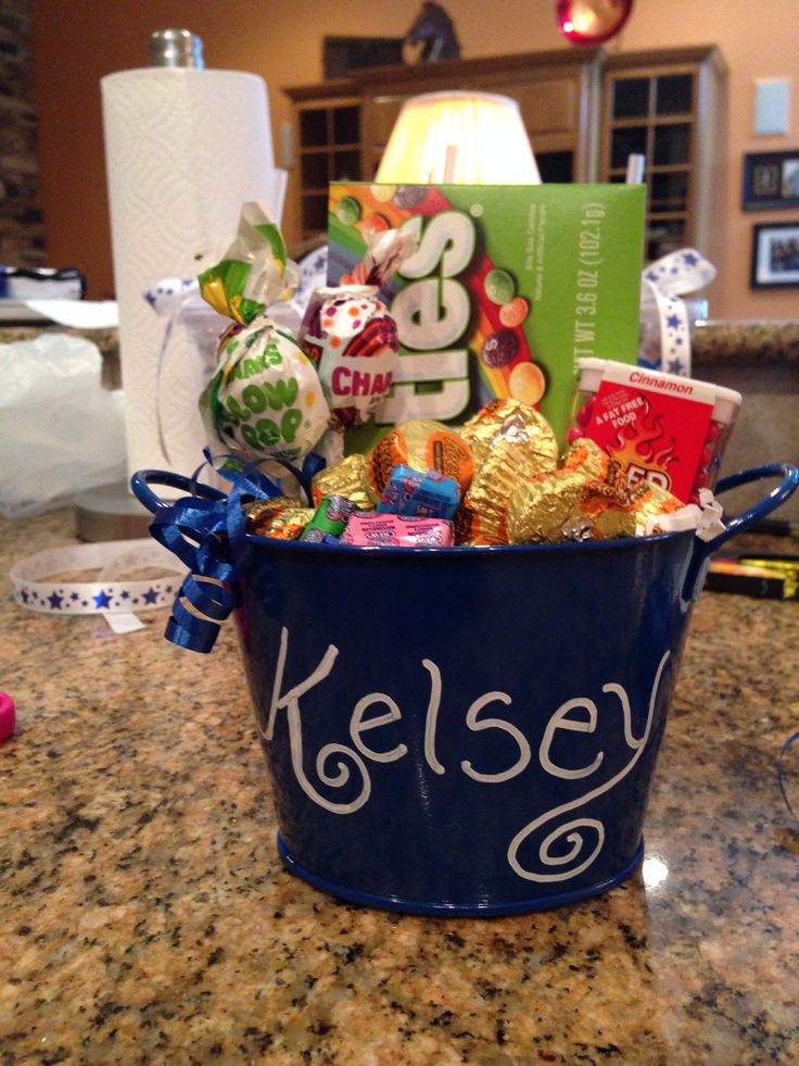 Cheer - small tin personalized & filled with candy for our cheer girls.  Added to a cheer basket. Cute!