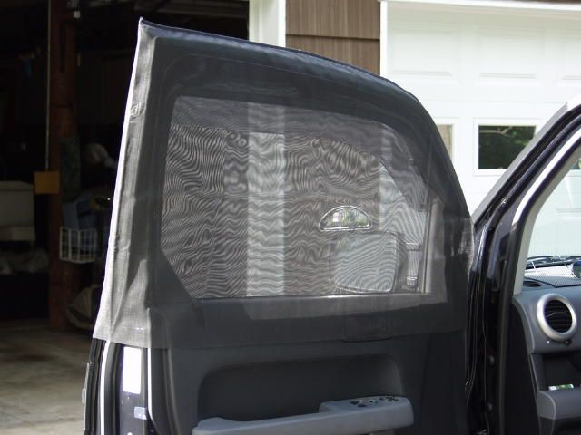 1st photo of car window bug screens, [DIY and aftermarket (Skreenz)].  This version slips over the top of the door and velcros around the side mirrors.