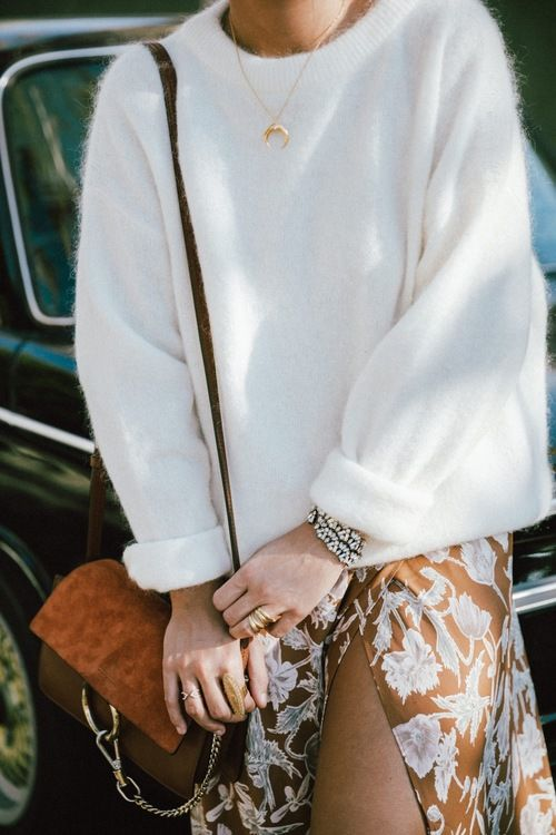 Add femininity to an oversized sweater with a slit maxi skirt.