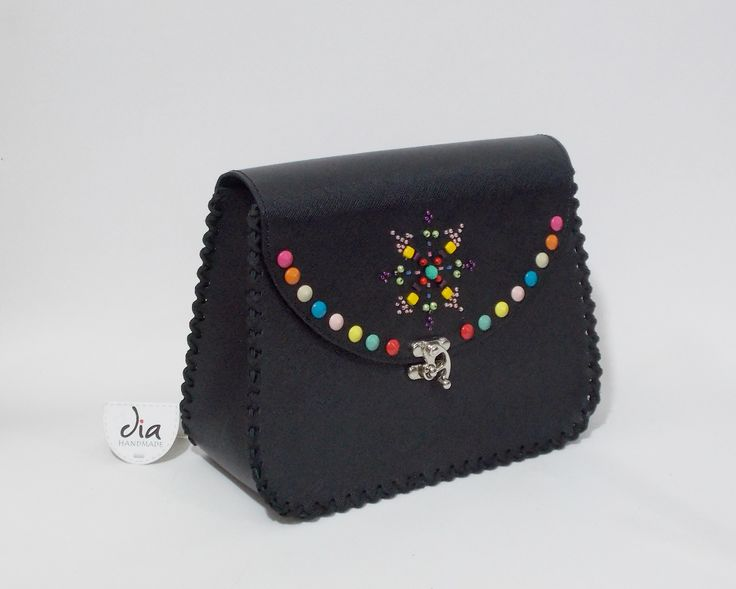 Handmade leather bag with manual embroidery