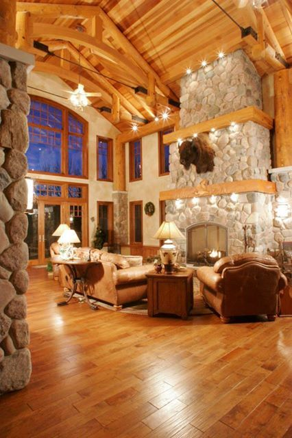 Great living room and stone fireplace too..love the floors and ceiling.