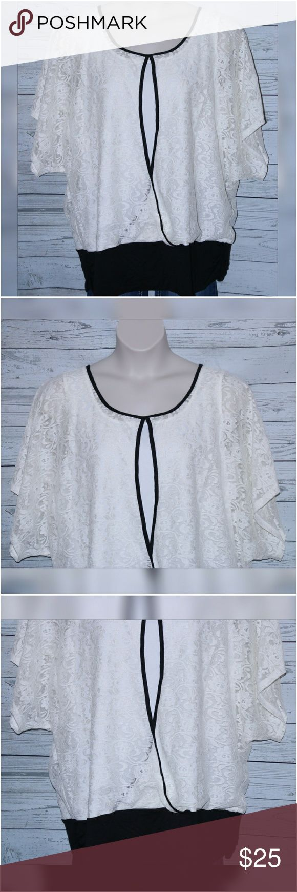 """NWOT Maurices Women's Plus Size 3 3X Lace Top NWOT Maurices Women's Plus Size 3 3X Cream Black Keyhole Lace Cami Lined Top Blouse  All measurements are approximate and  taken unstretched and laying flat.   Chest: 50""""  Length: 31""""  Sleeve: 14.5""""   If you have any questions, please don't  hesitate to send me a message.  Please feel free to check out the other  items listed in my store.   Note to Buyers:  **Colors may vary slightly from photos of item, due to lighting, camera, editing…"""