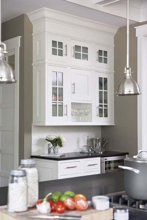 Cabinet color is Sherwin Williams Pure White. Wall color is Benjamin Moore Berkshire Beige. Linda McDougald Designs