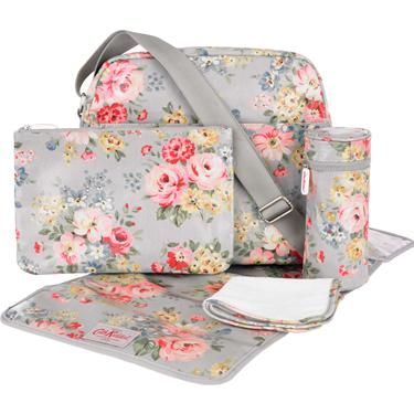 Our new shape nappy bag in this gorgeous Spring Bouquet print contains everything you need for a day out with baby. Includes changing mat, bottle insulator, baby flannel and large zip pouch, perfect for storing dummies, baby wipes and other bits and bobs. A fabulous gift for a new mother.