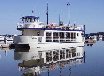 Port Perry's charming downtown:  Woodman boat tours of serene Lake Scugog.