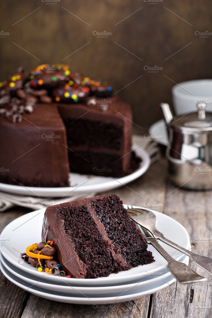 Chocolate cake decorated with donuts by farwasser on @creativemarket