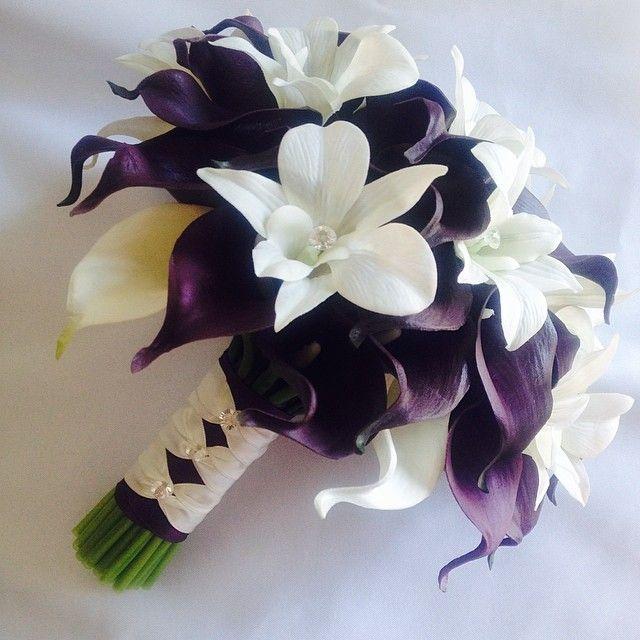 Stem wrap of the bridal bouquet; eggplant base with ivory French knots. #weddingbouquets #eggplantcallas #purpleweddingflowers
