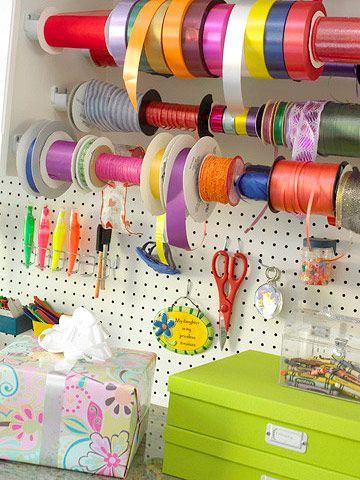 Dowels, pegboard, and acrylic containers keep Carol Watson's gift-wrapping supplies organized and at her fingertips.