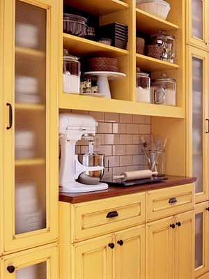 i like the mix of open shelving, kinda foggy cabinets and solid cabinets... a nice way to have those open shelves and still have a chance to be messy and unorganized