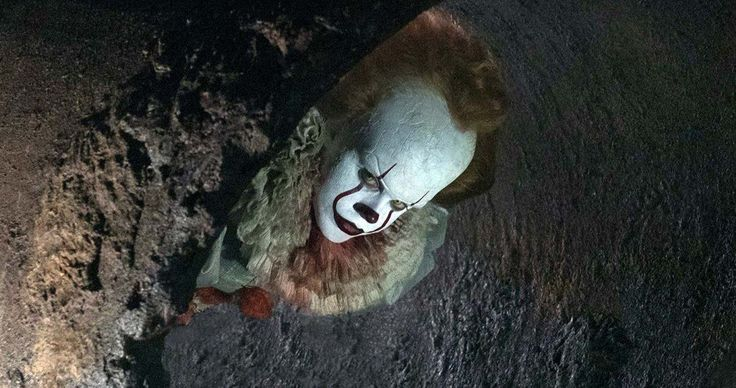 Pennywise Comes Out of Hiding in Latest IT Photo -- Pennywise the clown is seen lurking in the sewers of Stephen King's IT adaptation. -- http://movieweb.com/it-movie-2017-photo-pennywise-clown-sewer/