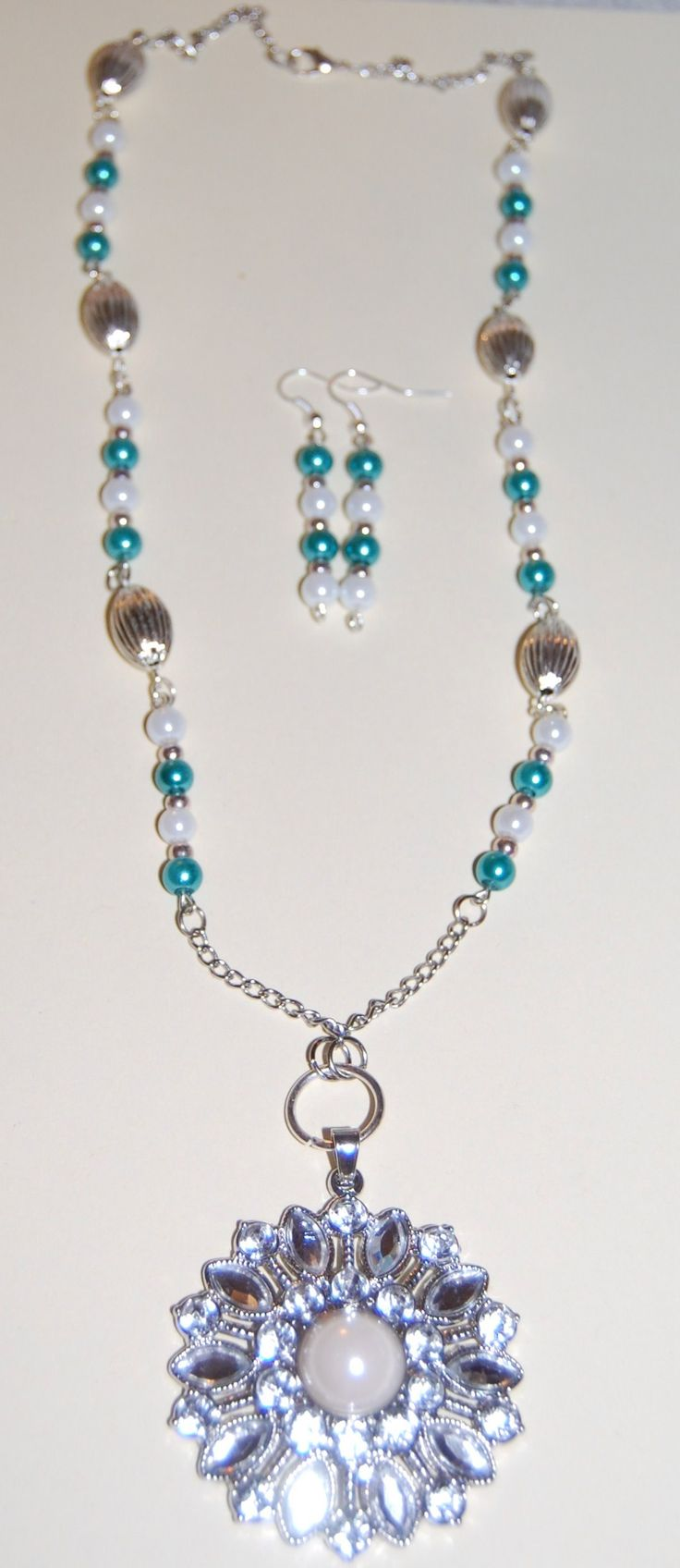 Women's necklace and earrings.