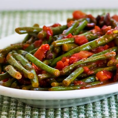For something new to do with garden green beans, these Braised Green Beans with Garlic, Tomatoes, Olives, and Capers are amazing, and this recipe is as easy as it gets! [from KalynsKitchen.com] #LowCarb #Paleo #GardenCooking