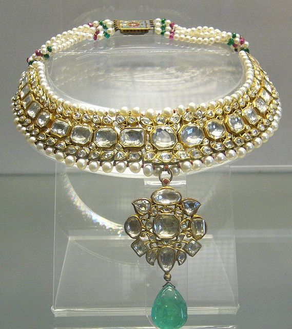 An 18th century raw diamond necklace featuring an astonishing emerald with pearls and rubies throughout. The piece is part of a collection on display at the British Museum in London and stems from India under Muslim rule.