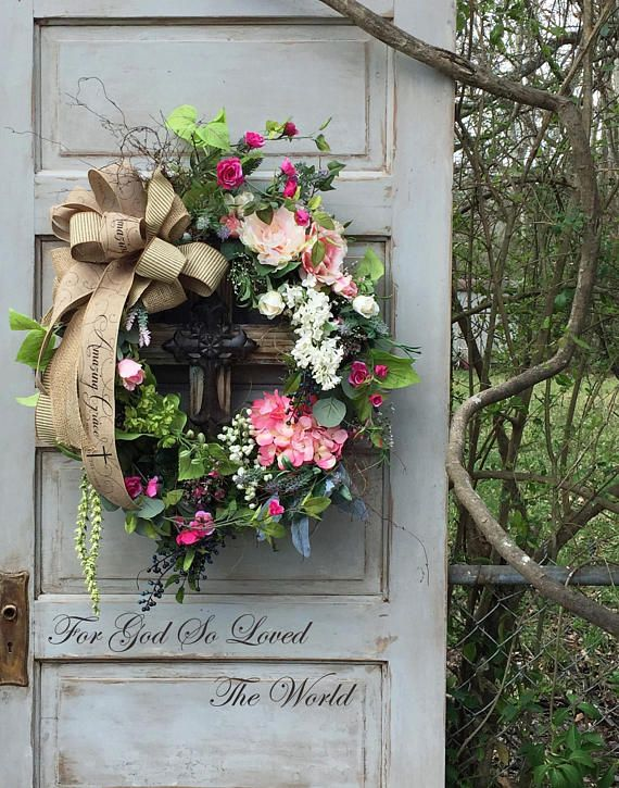 This Beautiful Easter Wreath is made on a Grapevine Base. I have Layered it with an Assortment of Spring Greenery, Chartreuse Colored Delphinium, Pink Hydrangea, Light Pink Peony, A Large Rose Head, Rose Buds, Berries, Climbing Rose Stems, White Lilac, and other Spring Florals. I