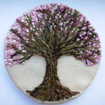 Couched tree in blossom. Might just have to learn a new craft to make something like this...