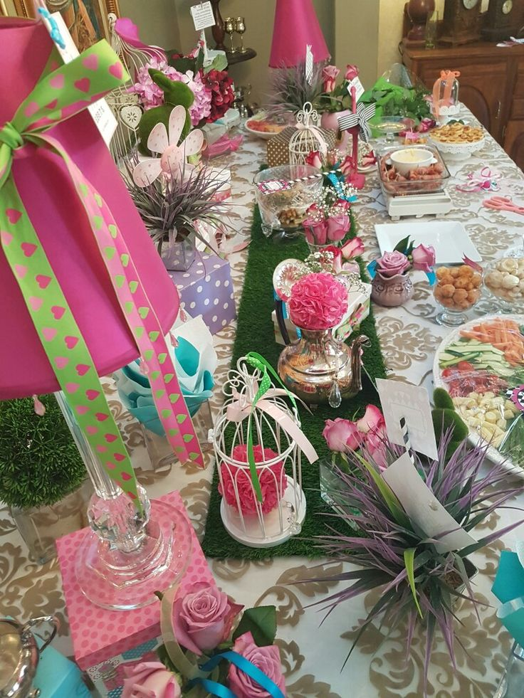 Mad Hatters table decor fun..ribbons, roses, bunnies and tea cuos