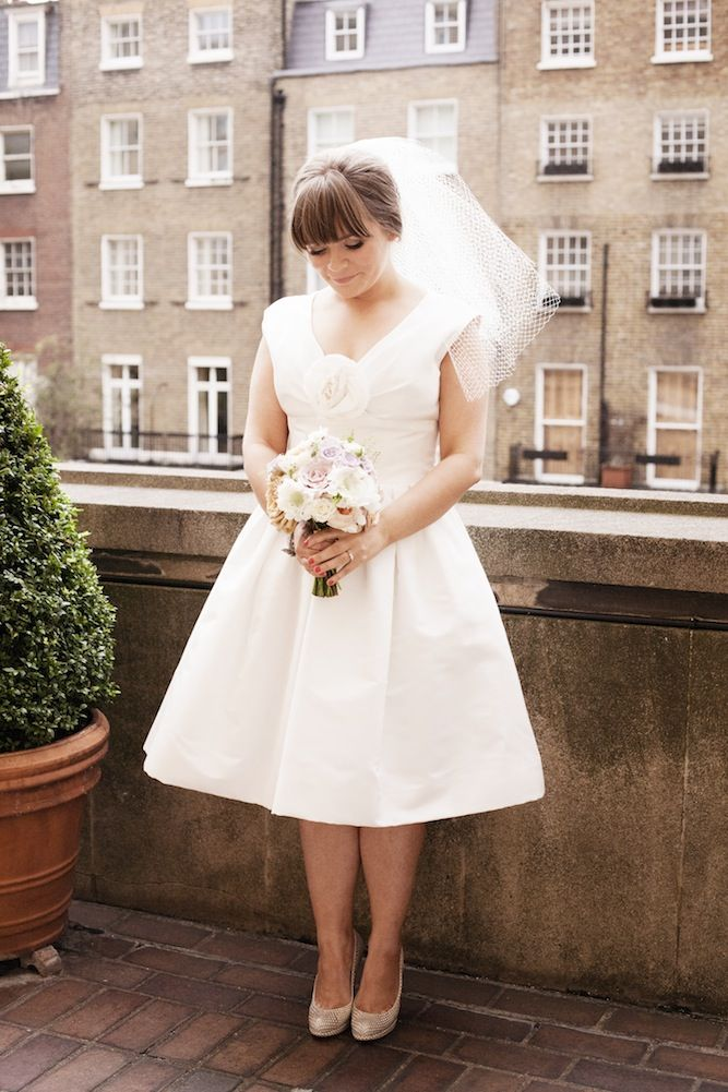 love this bride's sweet 60s style - cute bangs, short wedding dress & sky high Louboutins!     photo by Lucy Birkhead Photography