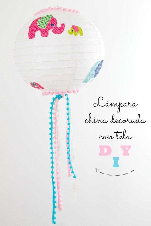 Cómo decorar una lámpara china con diseños de tela