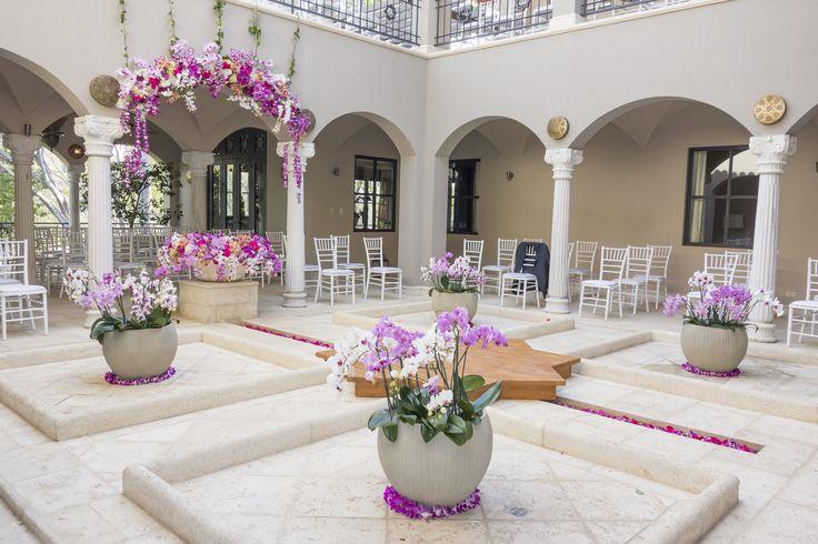 Wedding ceremony decoration with bright purple - pink flowers