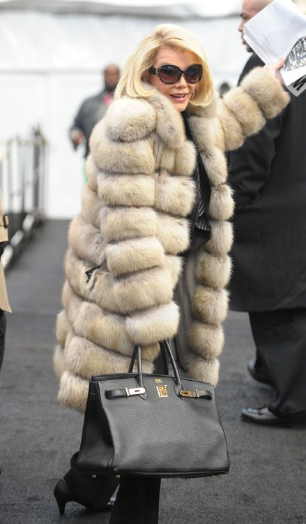 On the opposite end of the Hermes spectrum, inimitable comedian Joan Rivers went with a classic combination – a big fur and a big Hermes Birkin.