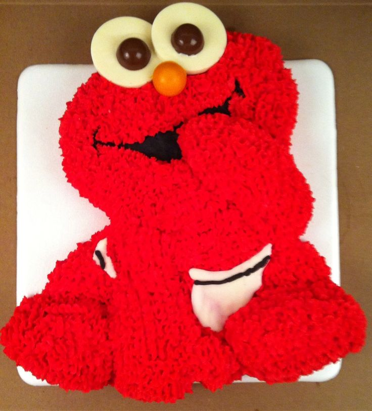 Baby Elmo cake with frosting and chocolate accents