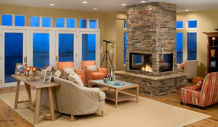 4-sided see through fireplace with stone surround... Beautiful Fireplace, would be nice between dining & living area