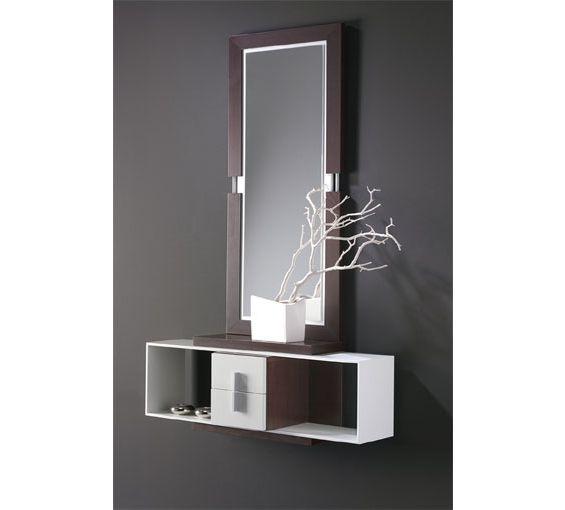 Le presentamos este fabuloso mueble de entrada compuesto por espejo y repisa con dos cajones, en un elegante y moderno diseño con el que decorar su hogar. Disponible en color wengué y hueso.