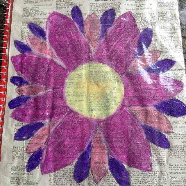 Newspaper flower on notebook