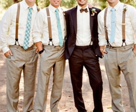Groom and groomsmen different tuxes. richards guys would never dress like this though lol