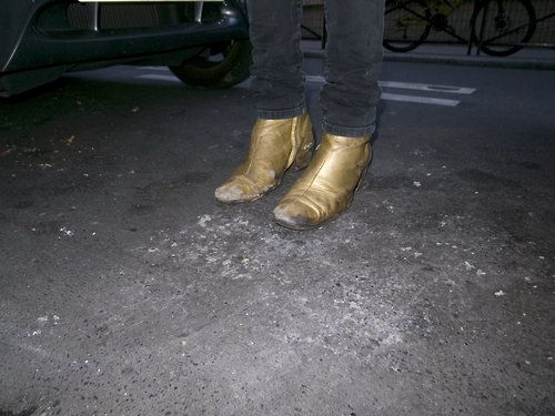 Alison Mosshart's golden boots by Marc Jacobs.