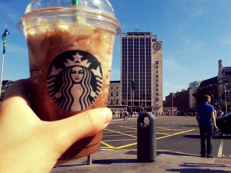 Enjoying some Starbucks on a hot day in Dublin's City Centre.