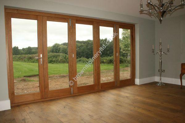 Solid Timber Bi-folding Sliding Doors to Border Oak House by www.brownsjoineryltd.co.uk