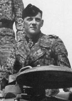 Balthasar Woll SS Oberscharfuhrer. Bobby Woll was Michael Wittmanns gunner. He was probably the best tank gunner in WW2. He had a talent to locate hidden enemy anti tank guns and destroy them before they knocked out his panzer. However he will be most remembered for his deadly targeting of enemy tanks, guns, vehicles. A truely great soldier. He was one of few gunners to receive the Ritterkreuz.