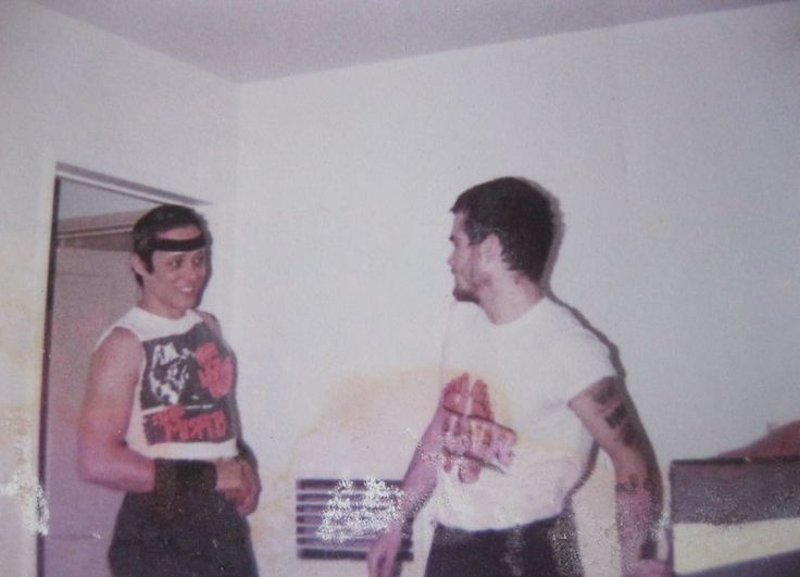 Jerry Only (left) flips his devilock back to have a conversation with Black Flag singer Henry Rollins circa April 1982. What a nice-looking boy under all that greasepaint and those spikes! Photographer unknown.