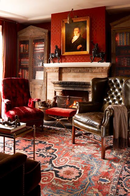 "What makes a place cozy? This is more ""grand"" than you usually associate with the word, but the warm rich wallcovering, the deep oriental rug & the fireplace all spell cozy to me. Bring in books, leather wing chairs & even a throw & the elements just add up."