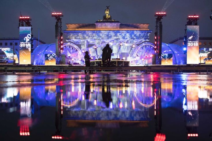 Germany's illuminated Brandenburg Gate for New Year's Eve  - New Year's Eve: Millions around the world welcome 2018 with fireworks, celebrations  - January 1, 2018.  The illuminated Brandenburg Gate reflects in a puddle during a rehearsal New Year's Eve party in Berlin, Germany.