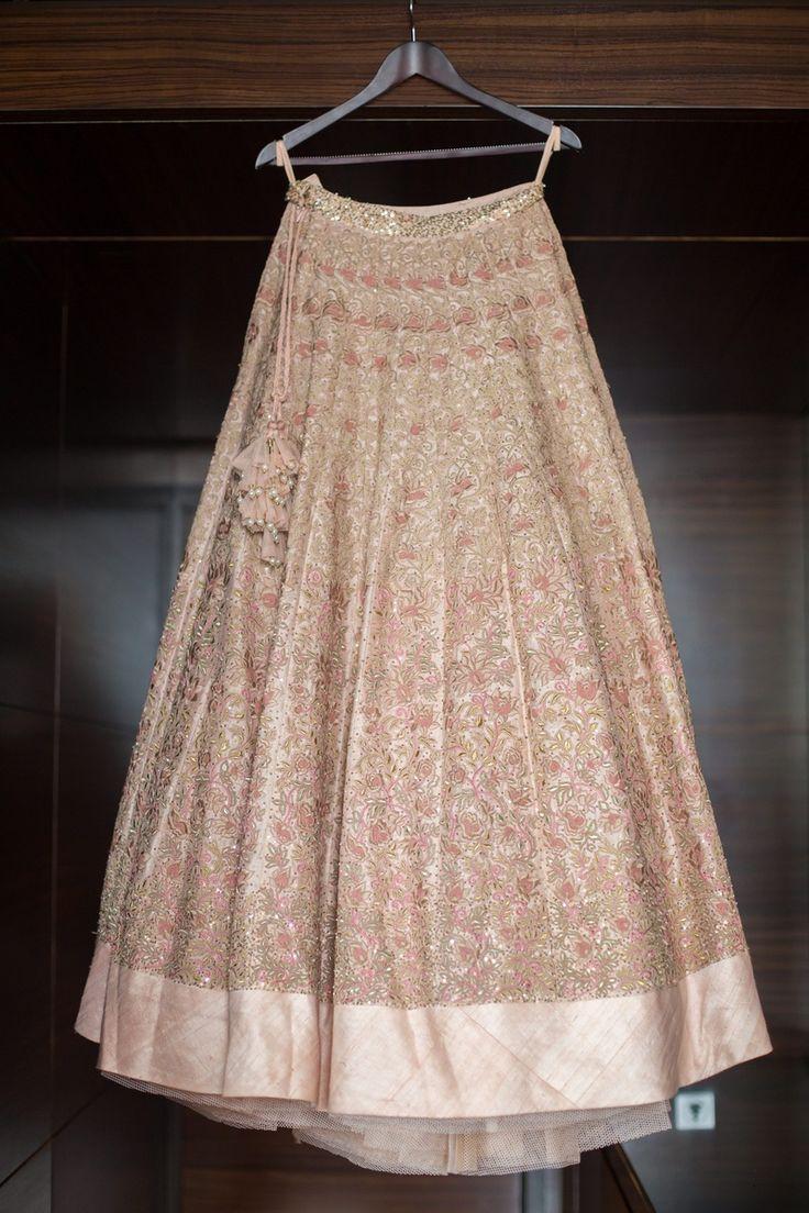 Pastel pink wedding lehenga embellished with embroidery motifs and matching latkans by Shymmal and Bhumika.| weddingz.in | India's Largest Wedding Company | Wedding Venues, Vendors and Inspiration | Designer Bridal Lehenga |