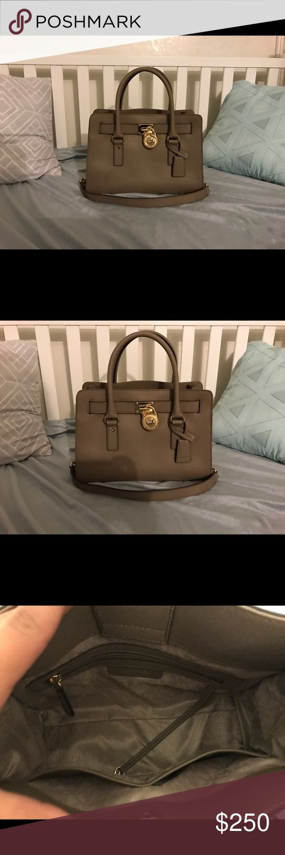 Authentic Michael kors purse Yes this is authentic comes with duster bag it is an amazing bag detailed with gold only worn once it is almost like new no flaws Michael Kors Bags Crossbody Bags