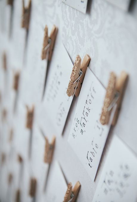 Brides.com: The Most Pin-Worthy Real Wedding Details of the Week: April 25, 2014. For escort cards, a bride hand-stamped individual envelopes with seating assignments. (A personal note from the bride and groom was tucked inside!) Another DIY touch? The gold glittered clothespins on each card.  See more photos from Danielle and Marc's laid-back, DIY Oakdale, New York wedding here.