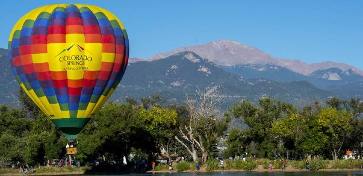 Colorado Springs Olympic City Ballon floating just above Prospect Lake. It's near Memorial Park where all the ballons lift off for the Labor Day Balloon Festival.