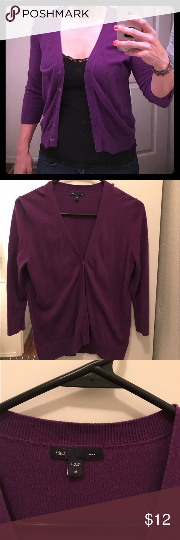 GAP Women's Purple Cardigan Size Medium GAP  Women's Cardigan. Size Medium. Purple. Buttons down. Perfect for over a dress or a tank. Can dress up any outfit. Cute for the office or a night out. GAP Sweaters Cardigans