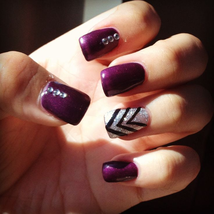 Purple gel acrylic nails with chevron stripes and a glitter background. These are perfect for you if your a person who loves purple and simply darker colors, it's a perfect look for winter or even Halloween. You can even change it up a little and have your nail stylist do one whole nail with tiny stones. I got these done at a nail salon, the only thing I wasn't too fond of was the shape of the nails I would have preferred a thinner nail with a less wide end, but that can all be fixed (: