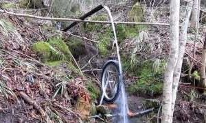 Beautiful Homemade Off Grid Water Turbine Made From A Bike Wheel And PVC Cups http://www.thegoodsurvivalist.com/beautiful-homemade-off-grid-water-turbine-made-from-a-bike-wheel-and-pvc-cups/   #thegoodsurvivalist