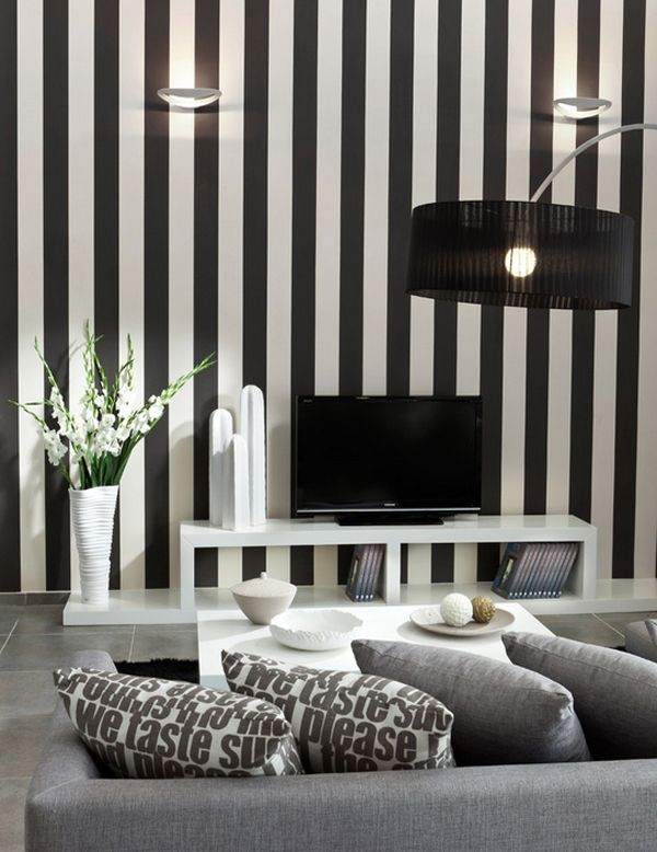 Black and white vertical stripes in a cozy small living room
